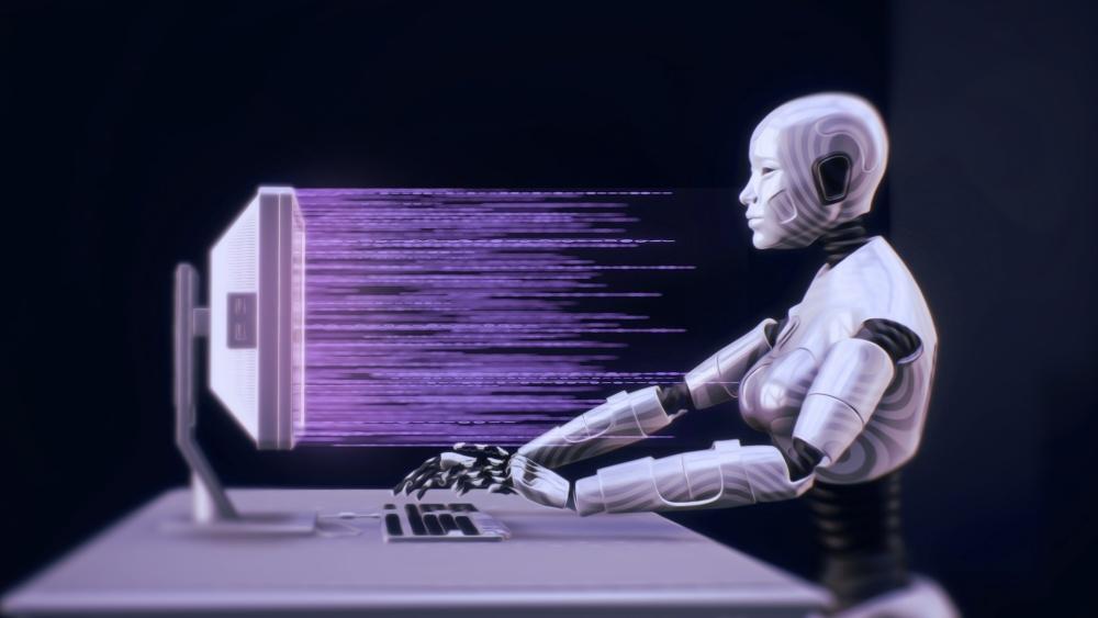 Roboter sitzt an PC und tippt auf einem Keyboard